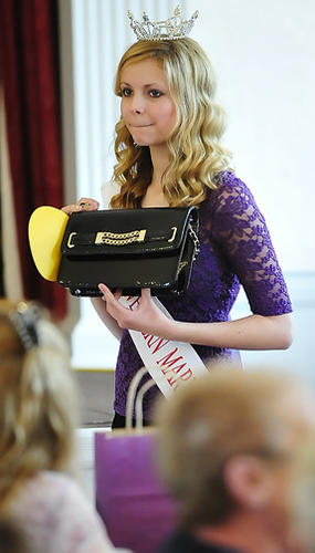 Miss Western Maryland Outstanding Teen Sara Farmer shows off a designer purse Sunday at a bingo fundraiser for two scholarship pageants. The event was held at the Women's Club in Hagerstown.