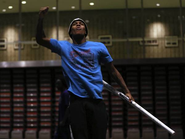 Greg Burrell, a member of the South Shore Drill Team, practices a routine Wednesday at the Gary Comer Youth Center. The team is the only group from Illinois that will march at President Barack Obama's inauguration Jan. 21 in Washington.