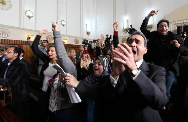 Supporters of Hosni Mubarak cheer in a Cairo courtroom after judges ordered a new murder trial for the former Egyptian president.