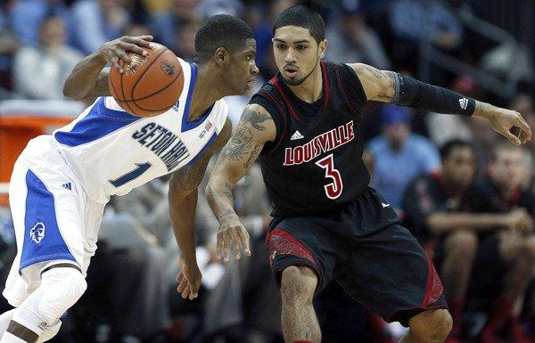 Louisville guard Peyton Siva (3) defends against Seton Hall guard Aaron Cosby (1) during a Big East Conference game Wednesday.