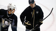 CANONSBURG, Pa. (AP) — Pittsburgh Penguins coach Dan Bylsma was in the midst of a little speech during his first day at his normal job in eight months when his players stopped suddenly and raised their sticks in the air.