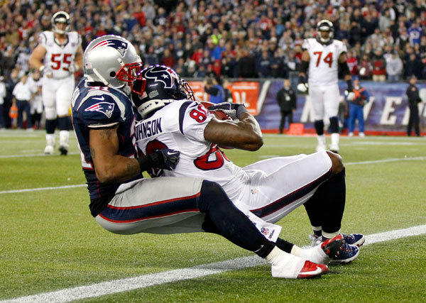 Houston Texans wide receiver Andre Johnson (80) catches a pass for a two-point conversion against New England Patriots cornerback Aqib Talib (31) during the second half of the AFC divisional round playoff game at Gillette Stadium. The Patriots won 41-28.