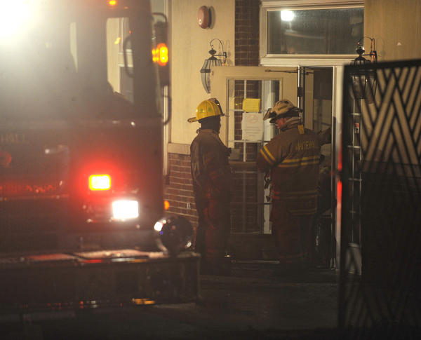 A fire at Whitehall Manor in Whitehall Township Sunday forced the temporary evacuation of more than 100 residents. The fire, caused by a bathroom fan in one of the assisted-living facility¿s units, produced a lot of smoke but was brought under control before emergency crews arrived, said Whitehall Fire Chief Bob Benner.