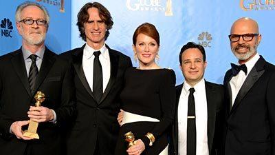 "The ""Game Change"" team: From left, producer Gary Goetzman, director Jay Roach, actress Julianne Moore, writer Danny Strong and producer Steve Shareshian pose with the award for miniseries or motion picture made for television."