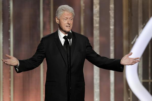 "The room full of stars received special guest Bill Clinton with a standing ovation. Steven Spielberg even threw him a salute. The former president introduced Spielberg's film ""Lincoln."""