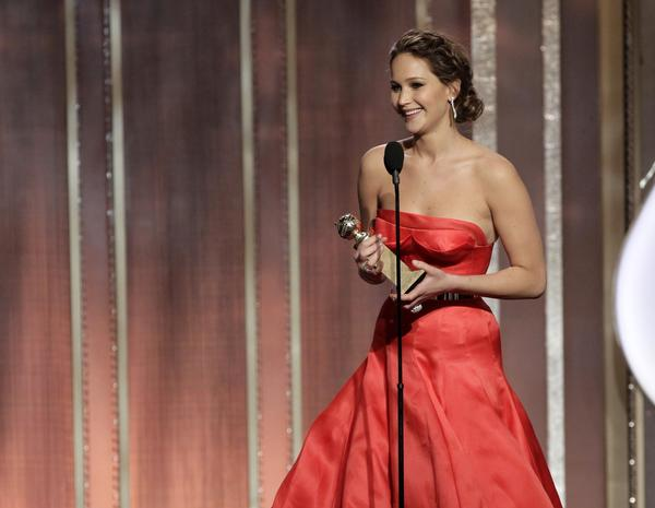 "Jennifer Lawrence accepts the Golden Globe for actress in a comedy for her role in ""Silver Linings Playbook."" <br><br>