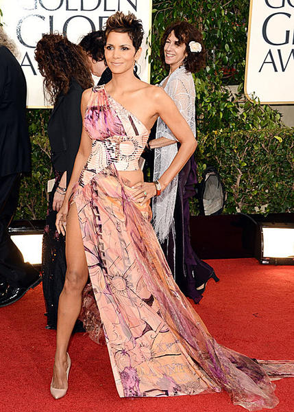 "Halle Berry accessorizes her Versace gown with Angelina Jolie's right leg, the breakout star of last year's Oscars. <br><br> <i>-- <a href=""http://www.twitter.com/drumoorhouse"">Drusilla Moorhouse</a>, <a href=""http://www.zap2it.com"">Zap2it</a></i>"