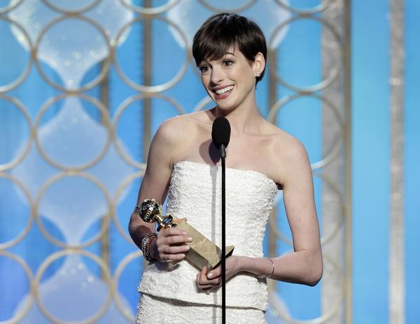 "Anne Hathaway accepts the Golden Globe for best supporting actress in a motion picture for her role in ""Les Miserables.""<br><br> ""I can't believe this is happening,"" Hathaway said. ""Thank you for this lovely blunt object that I will forevermore use as a weapon against self-doubt."""
