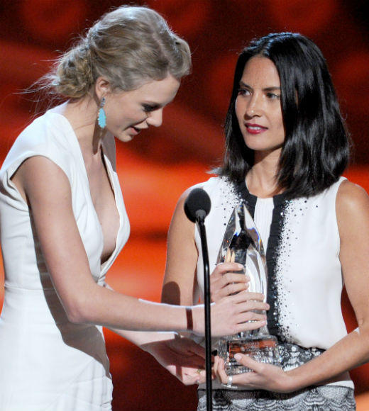 2013 People's Choice Awards: Best and worst moments: Yes, we did just turn Kanye into a verb. Olivia Munn presented Taylor Swift the award for Favorite Country Music Artist and decided to try to steal the spotlight from co-presenter Johnny Galecki by making a clunky joke about how Swift wrote We Are Never, Ever Getting Back Together about her. Unfortunately she didnt know when to let it go, because she ended up cutting into Swifts acceptance speech time. Munn quickly realized her faux pas, saying, Im not going to be that person, and exiting the stage. Good riddance.   --Terri Schwartz, Zap2it