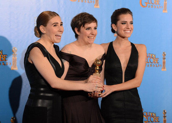 Lena Dunham (C) poses in the press room with her Best performance by an actress in a television comedy or musical series award for 'Girls' with co-stars Zosia Mamet (L) and Allison Williams at the Golden Globes awards ceremony in Beverly Hills on January 13, 2013.