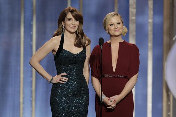 "After three years in a row of Ricky Gervais doing his best to shock the room as host of the Golden Globes, the duties were turned over to Tina Fey, left, and Amy Poehler. Though Fey and Poehler told people beforehand that they didn't have any intention of getting too mean, their opening jokes were tough enough to send Gervais slinking back across the pond. Among the highlights? ""When it comes to torture, I trust the woman who spent three years married to James Cameron,"" Poehler said in reference to ""Zero Dark Thirty"" director Kathryn Bigelow. ""Quentin Tarantino is here, the star of all my sexual nightmares,"" Fey said."