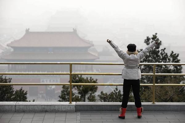 "A woman visits the Forbidden City in Beijing. ""The air pollution is unprecedented,"" said Zhao Zhangyuan of the Chinese Research Academy of Environmental Sciences."