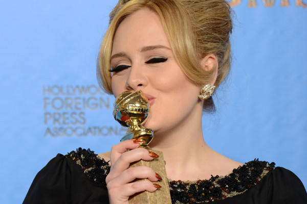 "Adele, smooching her Golden Globe for ""Skyfall"" earlier this month, will be performing the tune -- also nominated for an Oscar -- at the Academy Awards telecast next month."