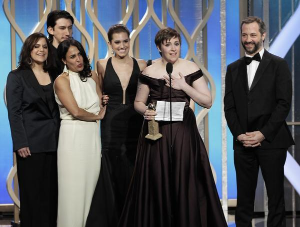 "Lena Dunham, star and executive producer of ""Girls,"" is joined onstage by her cast and crew as she accepts the Golden Globe for best comedy TV series."