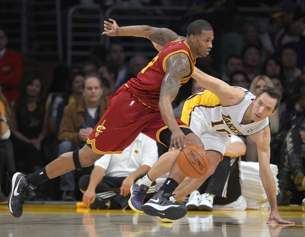Cavaliers forward Alonzo Gee, left, drives toward the basket as Lakers guard Steve Nash defends.