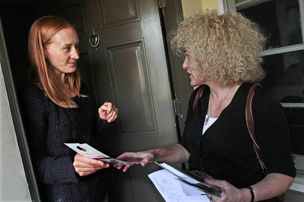 "West Hollywood resident Nicole Paterson, left, receives information on a term-limit proposal from Lauren Meister. ""People feel like there's a machine and that their votes don't count,"" Meister said."