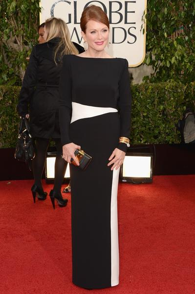 Julianne Moore epitomized the elegance of covering up, wearing a long-sleeved Tom Ford gown in black silk georgette with a modern-looking slash of white at the waist and down one side.