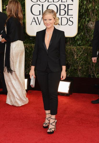 It's rare that you see pants on the red carpet. But Amy Poehler had the guts to walk the red carpet in a glamorous black pants suit by Stella McCartney. The jacket's deep front revealed a Chopard diamond lariat necklace, and the cropped pants showed off custom Charlotte Olympia strappy shoes. It was cute that she walked with her partner in crime, co-host Tina Fey, who wore a dress. It was as if the two were dates for the evening.