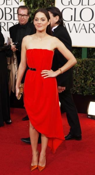 Marion Cotillard looked fresh and modern in a Raf Simmons for Dior orange velvet gown with drape front detail and asymmetrical hem.
