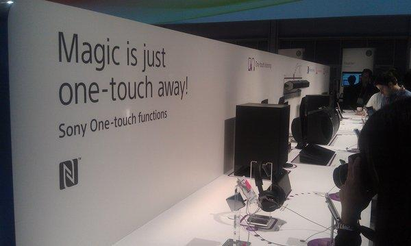 Sony demonstrates its one-touch feature, which lets selected smartphones send content easily to specially equipped TVs and stereos, at the 2013 Consumer Electronics Show in Las Vegas.