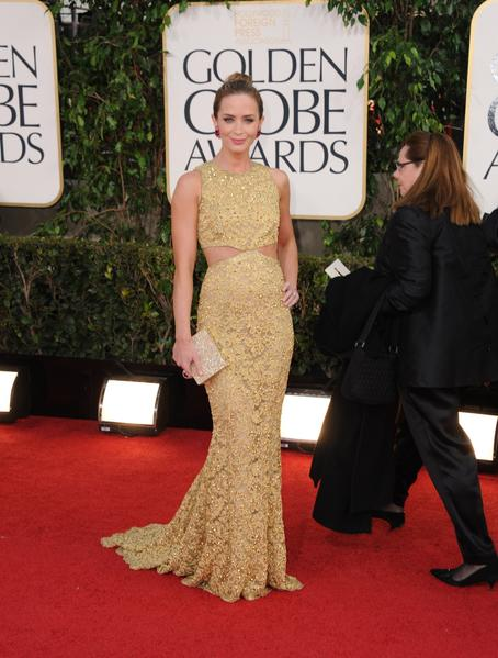 Emily Blunt, who wore a gold metallic lace chain Michael Kors gown, had the best of the night's big earrings, dazzling ruby danglers by Lorraine Schwartz.