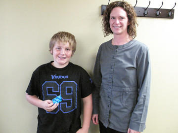 Landon Danielson, left, seen with Dr. Amy Scepaniak, won an iTunes gift card on Nov. 1 for donating his Halloween candy at Smile Solutions' annual Halloween candy buy-back event. The candy was sent to troops serving overseas via Operation Gratitude.