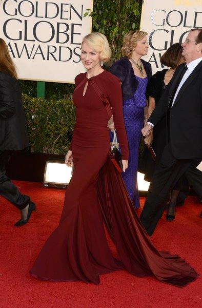 Naomi Watts' long-sleeved, backless cranberry gown by Zac Posen was covered up but sexy.