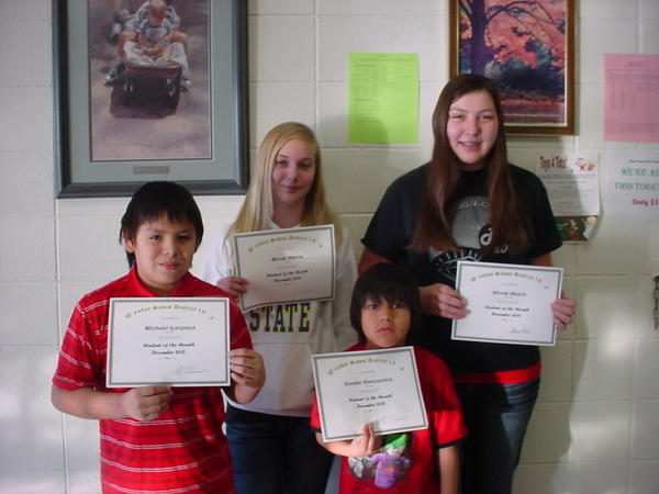 Waubay December students of the month are, from back left, Nicole Welch, Minda Warns, Michael Iyarpeya and Xander Rencountre were named  the students of the month at the Waubay School. Xander is in first grade and was chosen for his hard work and cooperation in the classroom. Michael, the son of Grace Iyarpeya, has received his third student of the month award. Minda, the daughter of Mary Warns, is always responsible and has been helping other students. Nicole, a high school junior, is the daughter of Loris and Charlotte Welch. She was chosen for being a dependable, respectful student.
