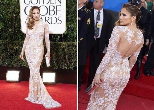 Jennifer Lopez, in a body-baring, long-sleeved cream lace Zuhair Murad gown, gave us the fashion moment we'd been waiting for, and one to rival the famously low-cut leafy Versace gown she wore to the Grammys in 2000.