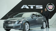 Automotive journalists named the Cadillac ATS sports sedan and the Chrysler Ram 1500 pickup truck as the North American car and truck of the year at the opening of the North American International Auto Show in Detroit.