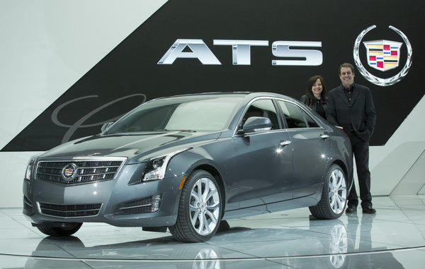 Standing with the Cadillac ATS are General Motors vice president for global product development Mary Barra, left, and GM North America President Mark Reuss.
