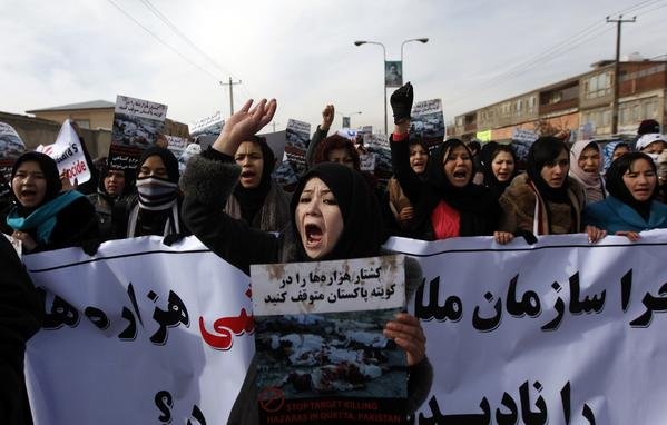 "Afghan Shiite Muslims gather to protest against Thursday's twin bomb attacks in the southwestern Pakistani city of Quetta, in Kabul January 14, 2013. The poster in the center reads, ""Stop target killing Hazaras in Quetta, Pakistan."""