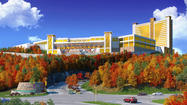 Mohegan Tribal Gaming Authority's bid for a casino in western Massachusetts moved forward Monday when the company filed its application and a $400,000 fee — one day before the state's deadline.