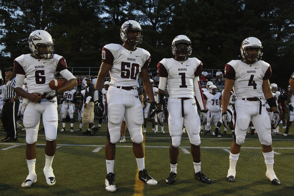 Windsor Warriors Robert Quinn Fleeting (6), Cole Ormsby (50), Ryhieme Moore (1) and Terrell Huff (4) wait for the coin toss before the start of the game against the Wethersfield Eagles at the Joseph F. Cottone Field at the Wethersfield High School.
