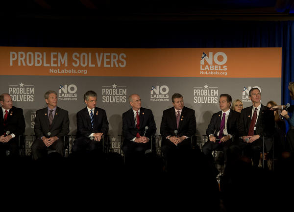 Congressman Charles Dent (third from right) participates in a town hall panel discussion during the No Labels conference at the Marriott Marquis in New York City on Monday.