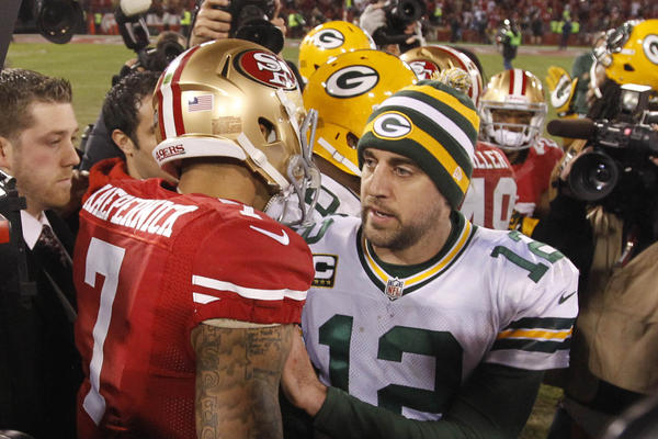 Packers quarterback Aaron Rodgers congratulates San Francisco 49ers quarterback Colin Kaepernick after the NFC divisional round playoff game Saturday at Candlestick Park.