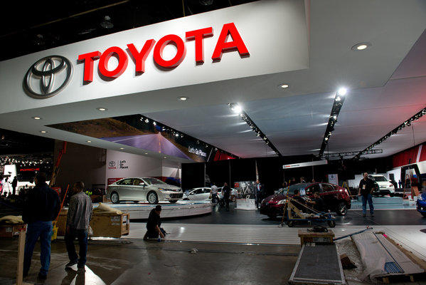 Workers prepare the Toyota booth ahead of the North American International Auto Show in Detroit.
