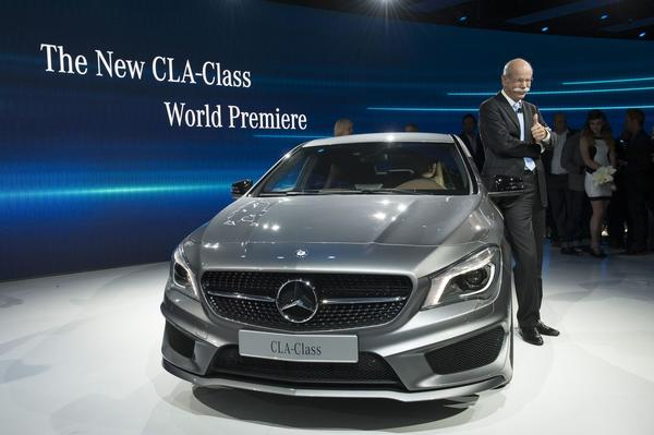"Dieter Zetsche presents the new Mercedes-Benz 2014 CLA-Class sedan a sporty-looking ""quad coupe"" during a private preview in Detroit."