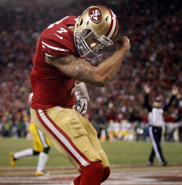 San Francisco quarterback Colin Kaepernick celebrates a touchdown.