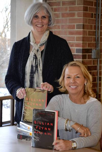 Terry Dason, left, executive director of the Winnetka/Northfield chamber of commerce, and Winnetka/Northfield interim library director, Juli Janovicz, were at the library for the Jan. 9 launch of the annual 'One Book Two Villages' reading program. The program features the mystery novel 'Gone Girl' by north suburban author, Gillian Flynn, and the children's book 'Liar & Spy Liar & Spy,' by author Rebecca Stead.