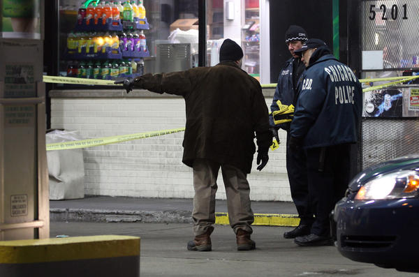 Chicago Police investigate a shooting at a BP gas station in the 5200 block of West Jackson Boulevard in Chicago. The shooting occurred around 4:30 a.m., after the victim, a 28-year-old man, got into an argument with another person.
