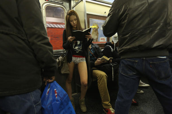 "People ride the subway pantless on January 13, 2013 in New York City. Thousands of people participated in the 12th annual No Pants Subway Ride, organized by New York City prank collective Improv Everywhere. During the afternoon winter event, participants boarded separate subway stops and removed their pants, pretending that they did not know each other. The event, referred to as a ""celebration of silliness"" is designed to make fellow subway riders laugh and smile."
