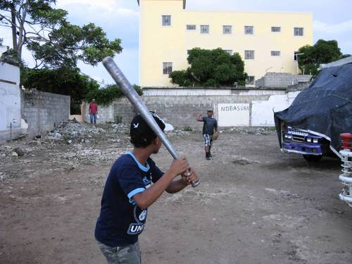 Boys play baseball in an empty lot in San Pedro de Macoris, one of the Dominican towns that sends the most professional baseball players to the United States. Sammy Sosa grew up in the town, where he famously shined shoes as a boy.