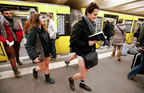 "People without their pants exit a subway train during the ""No Pants Subway Ride"" in Berlin January 13, 2013."