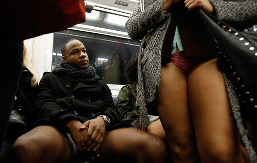 People take part in the No Pants Subway Ride on the uptown 6 train in New York January 13, 2013.