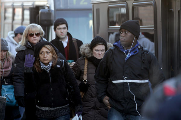 CTA riders disembark the #72 North Avenue bus at the CTA Red Line North/Clybourn Station today.