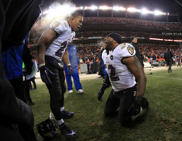 (L-R) Ray Rice #27 of and Ray Lewis #52 of the Baltimore Ravens celebrate after the Ravens won 38-35 in the second overtime against the Denver Broncos during the AFC Divisional Playoff Game at Sports Authority Field at Mile High on January 12, 2013 in Denver, Colorado.
