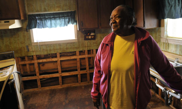 Hazel Cropper, 74, a crab picking competition champion, stands in the kitchen of the home she and her husband bought in 1974. Her house was flooded as Superstorm Sandy hit the area.