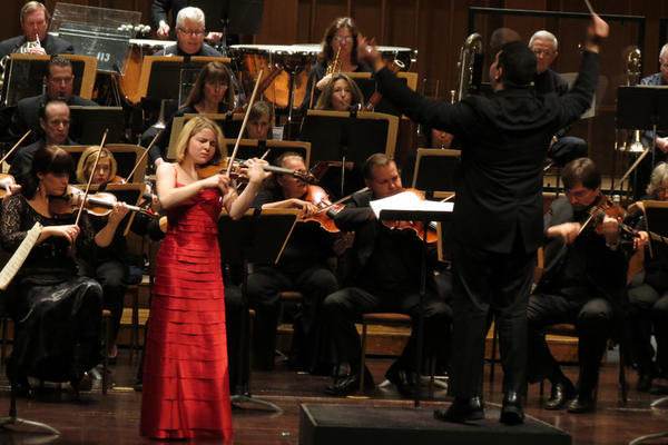 Violinist Caroline Goulding plays with the Pasadena Symphony Orchestra, conducted by Tito Munoz at the Ambassador Auditorium.