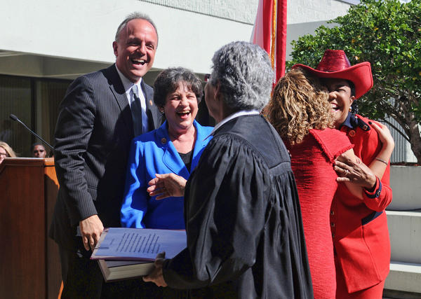 United States Representatives  (left to right background)  Ted Deutch (Broward/Palm),  Lois Frankel (Broward/Palm), Debbie Wasserman Schultz (Broward) and Frederica Wilson (Broward) were all smiles and hugs after being sworn in by the (foreground) Honorable Rosemary Barkett Monday at the Federal Courthouse in Fort Lauderdale.  Broward and Palm Beach County members of Congress were sworn in on Monday inside the heavily secured  Federal Courthouse in Fort Lauderdale.  The ceremony was previously held outside, but after Arizona congresswoman Gabby Gifford was shot in 2011,  Florida officials felt the need for a more controlled location.